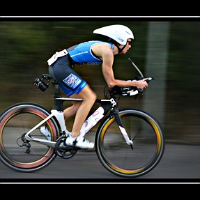 1/50 sec for motion pic cyclist. 70mm fl, from about 6m.