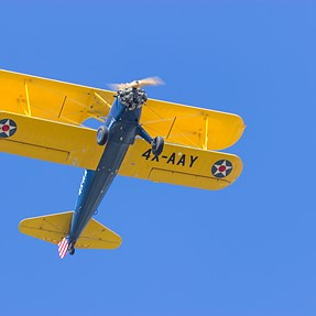 Old yellow plane above me